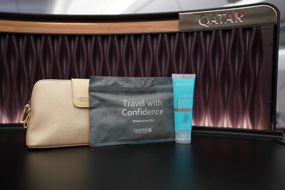 A beige pouch provided by Qatar Airways