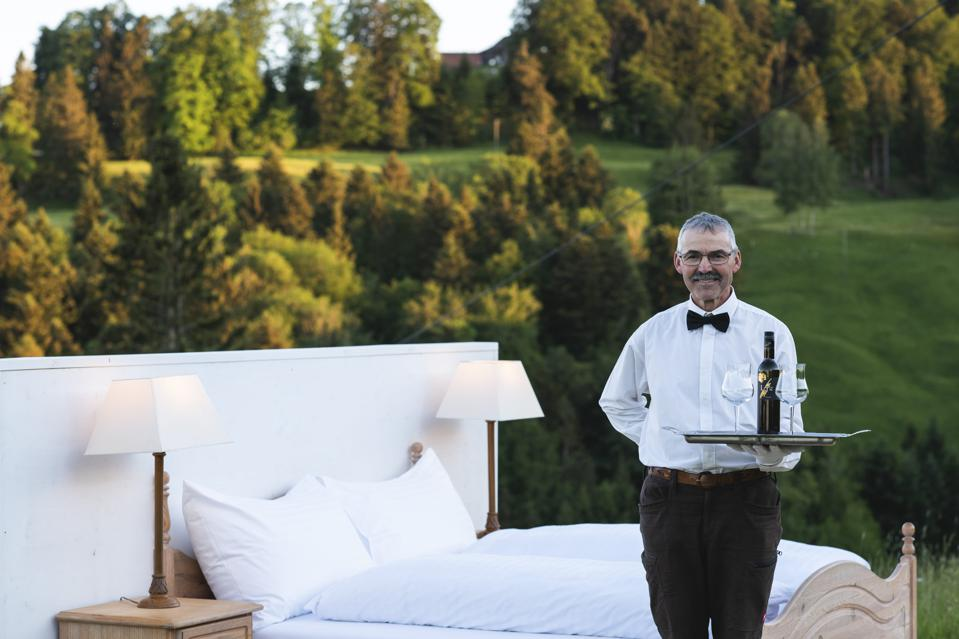 Wine is brought to the ″suite″ by waiters