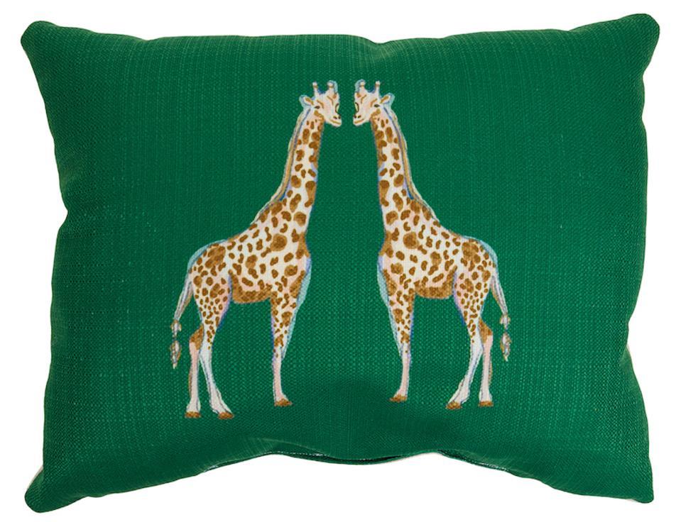 giraffe pillow with a green background