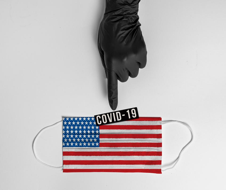 Glove pointing towards American flag.
