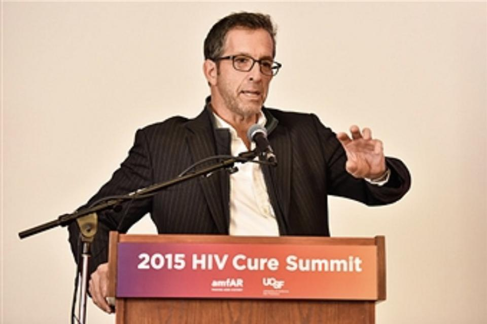 Kenneth Cole speaking at the 2015 HIV Cure Summit.