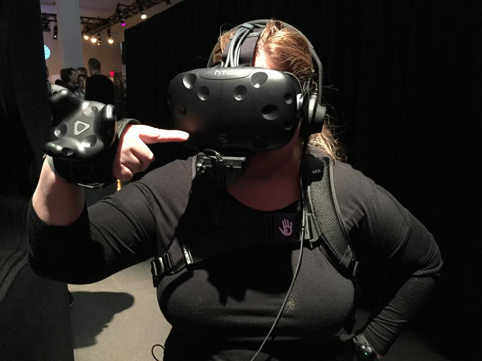woman uses VR for smelling