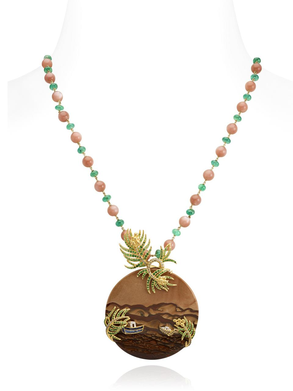 A necklace that depicts a lush oasis along the brown sands of the Gobi Desert