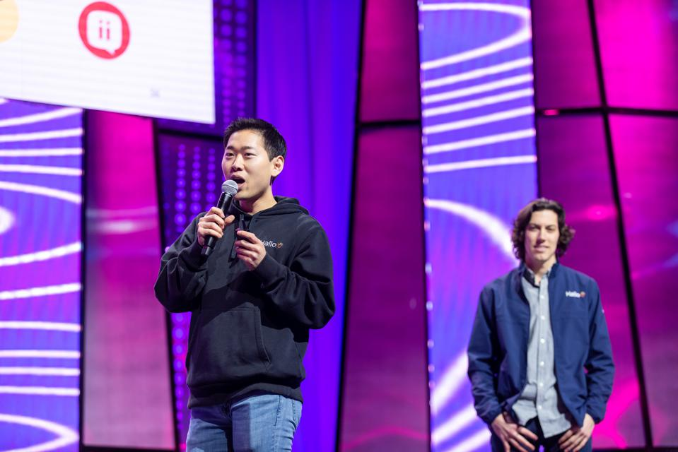 Joon and Ben presenting on stage.