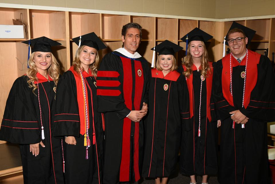 Rheann on graduation day with her classmates and commencement speaker, ABC's David Muir.