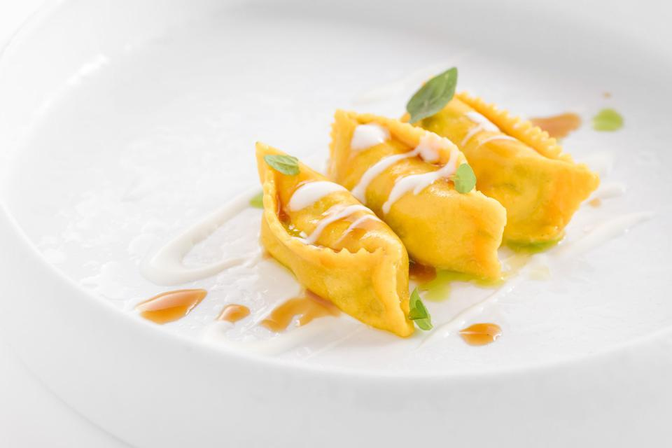Genovese style ravioli with a beef and onion filling, an 18-hour stew according to the typical recipe, and to finish, a fondue of Lodigiano cheese matured for 36 months