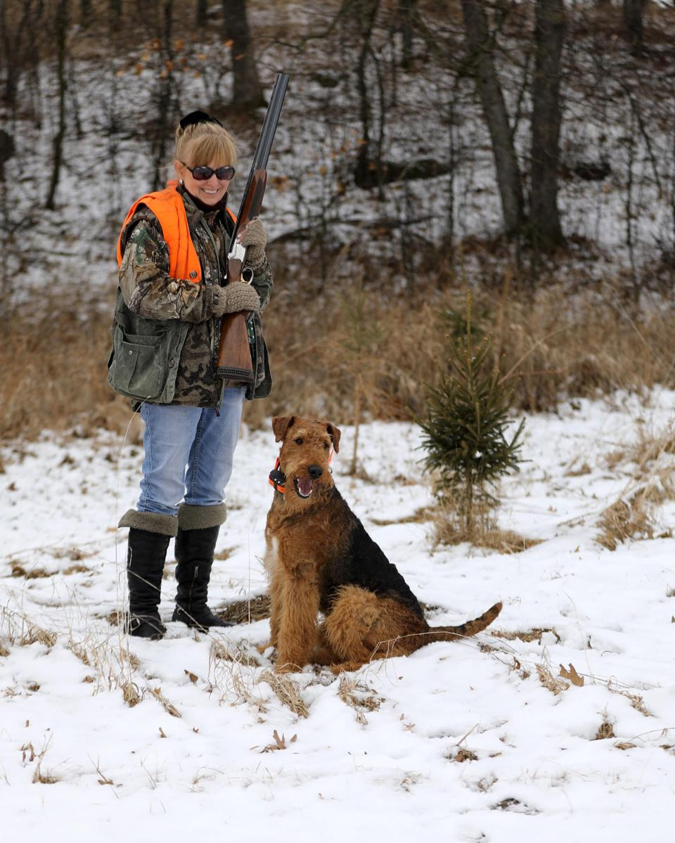Dr. Christine Thomas with her dog in the snow