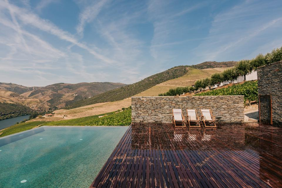 The swimming pool at Ventozelo has beautiful views over the Douro Valley in Portugal.