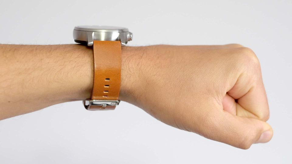 The Moto 360 on the wrist, viewed from its side.
