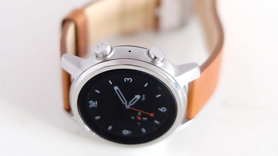 The Moto 360 on its side, showing its two buttons.
