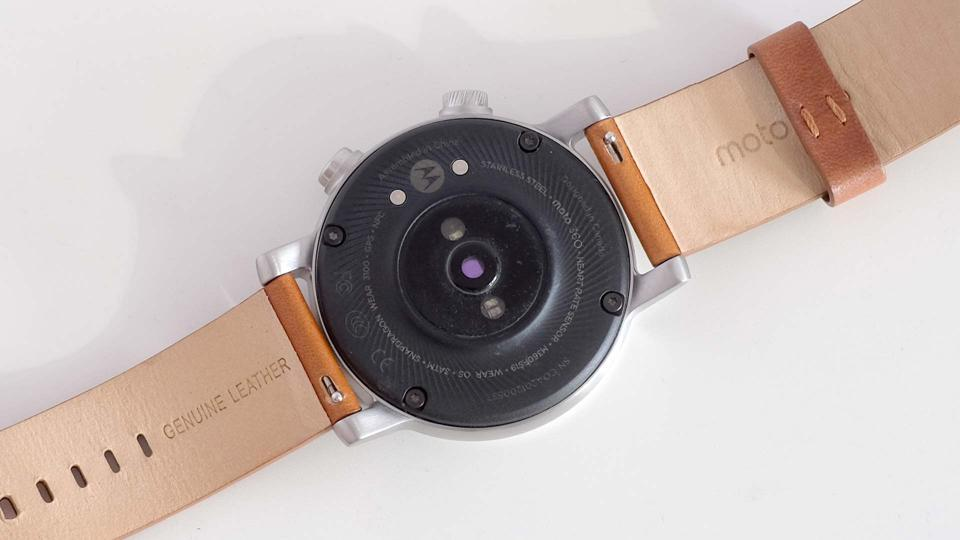 The Moto 360's rear, showing the heart rate sensor and charge points.