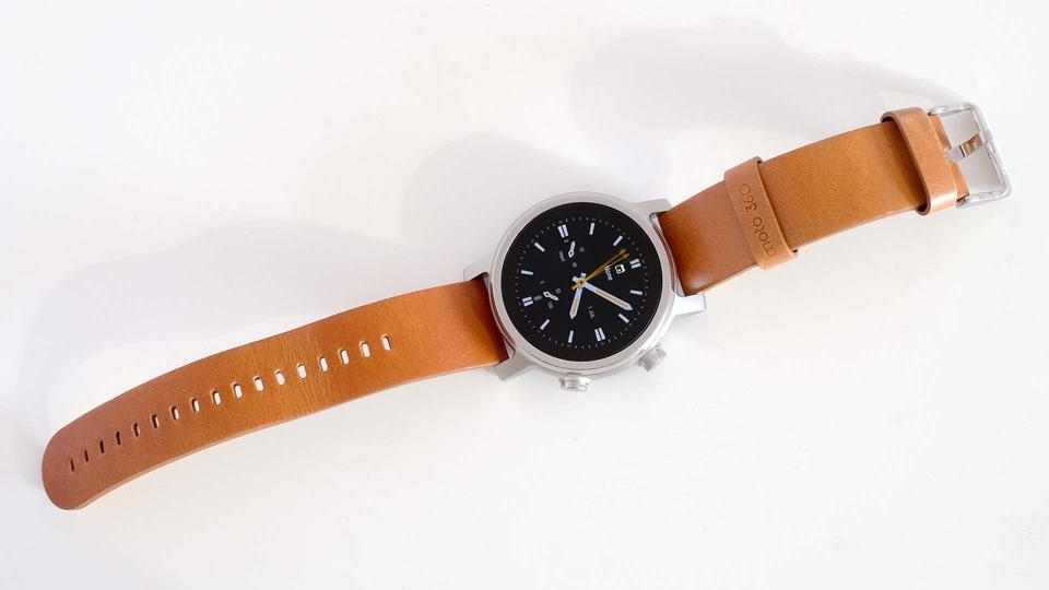 A photo of the Moto 360, showing the full length of its strap.