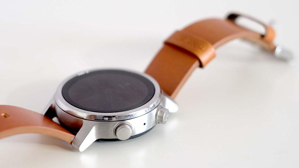 The Moto 360, photographed from an oblique angle.