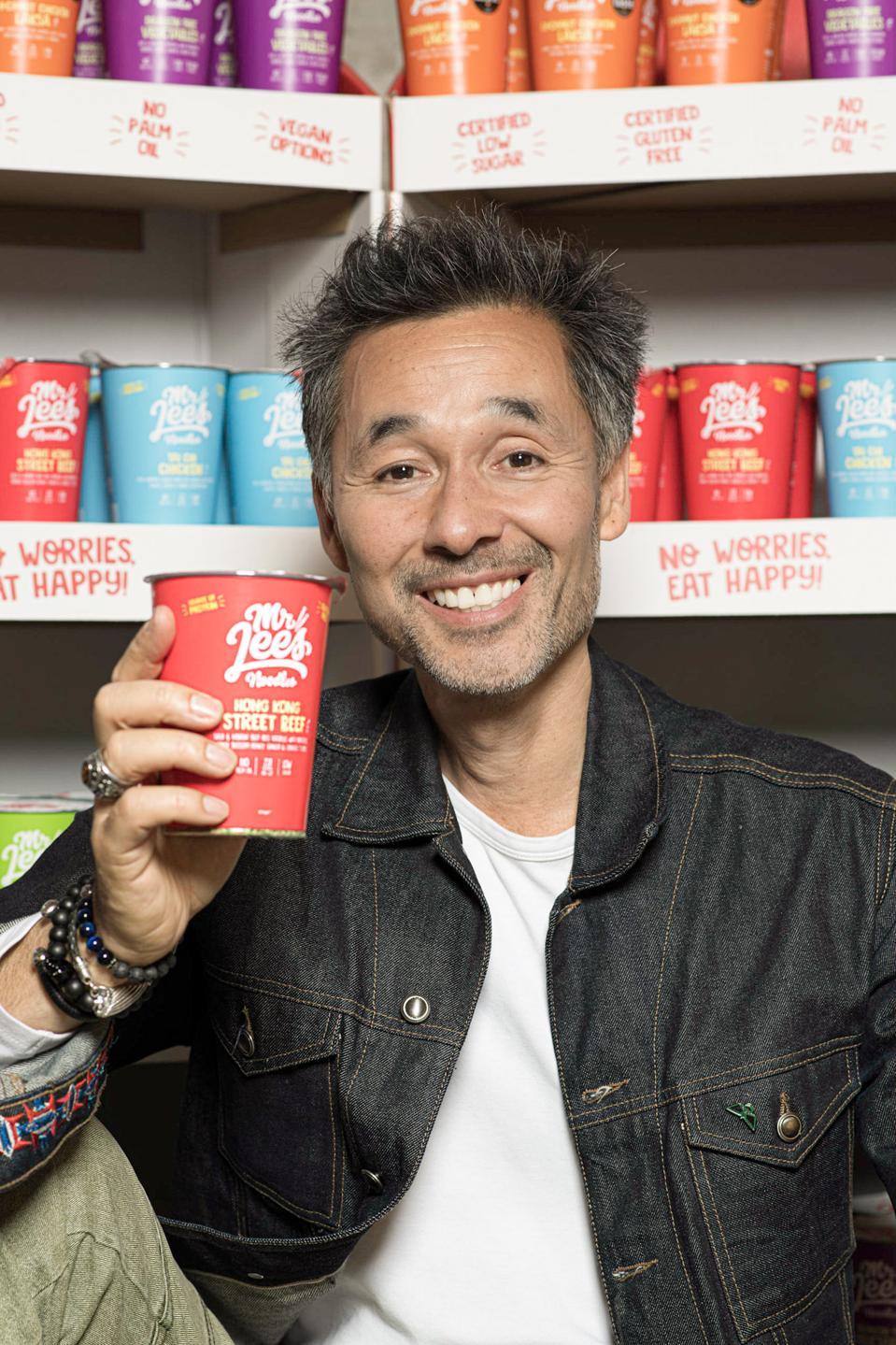 Damien Lee, co-founder of Mr. Lees Noodles, holding a cup of instant noodles