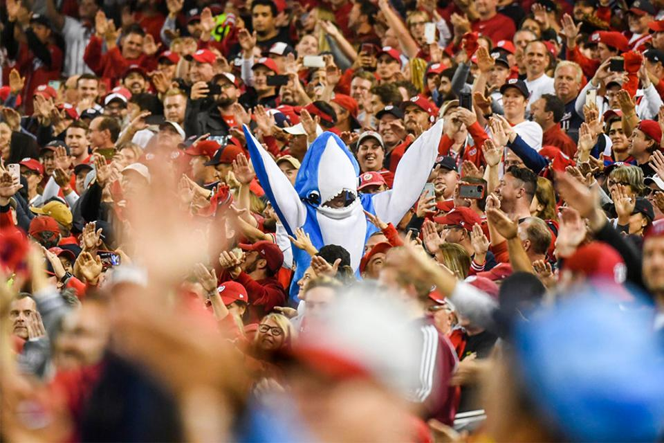 """Washington Nationals fans dance to """"Baby Shark"""" during a 2019 playoff game."""