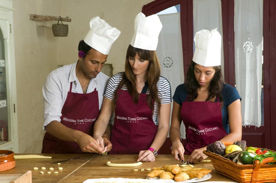 Making taralli biscuits at hotel Masseria Torre Coccaro cooking school Puglia Italy