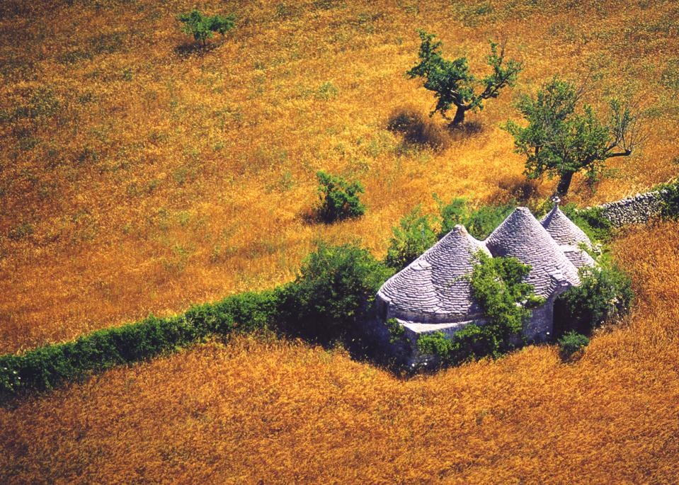 Trulli dry stone wall conical roof rural accommodations in Puglia Apulia Italy