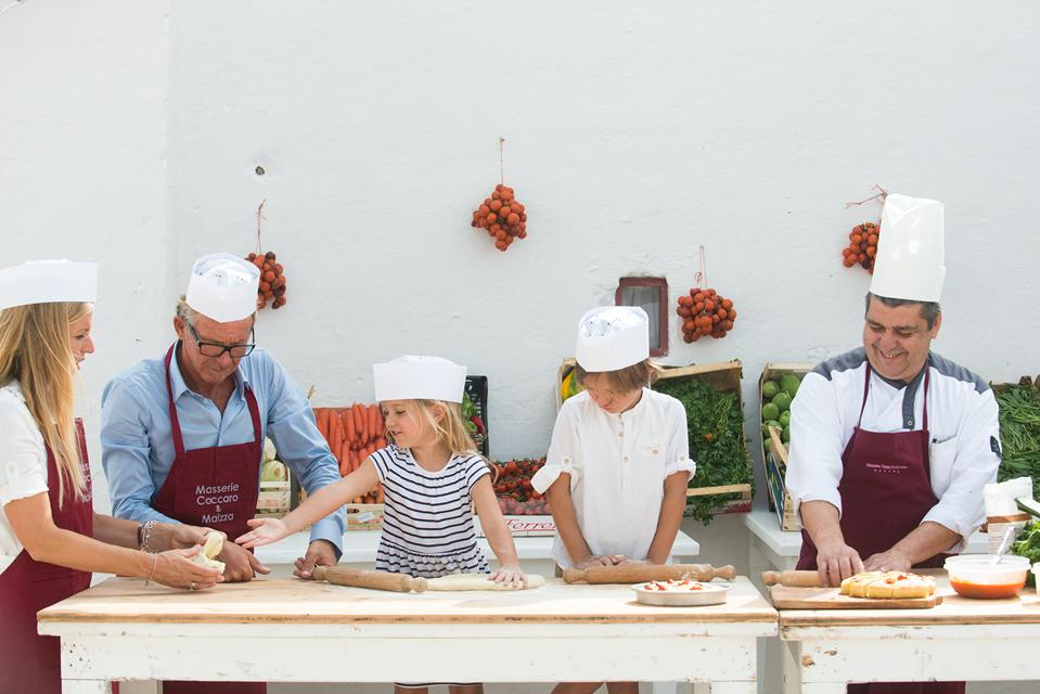 hotel guests join in cooking class with Masseria Torre Coccaro chef Donato Vannella Puglia