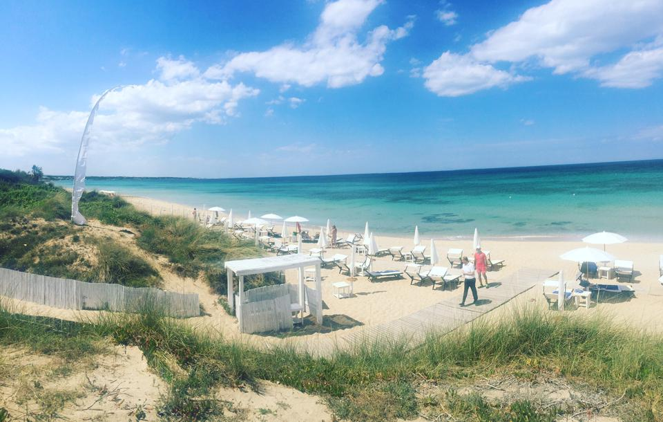 two people leave beach club luxury hotel Masseria Torre Coccaro Puglia Apulia Italy