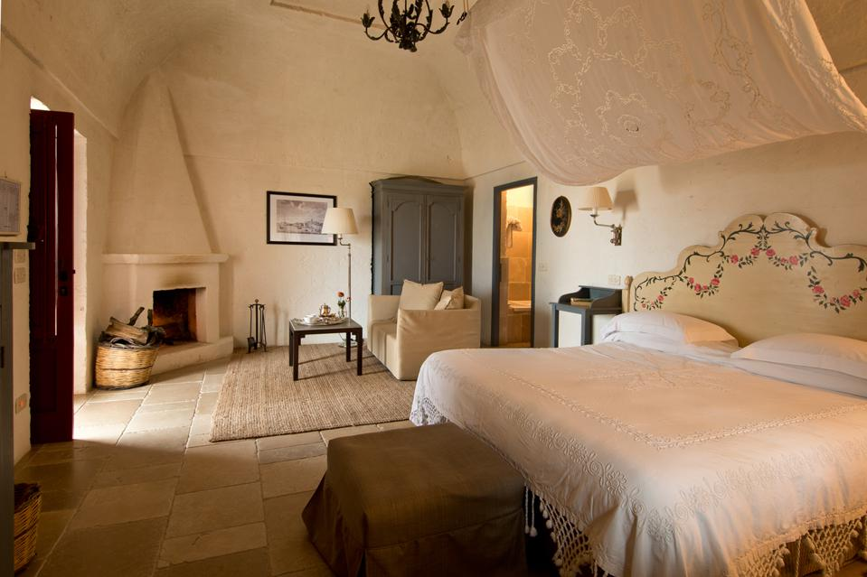 country style room with white stomen walls at Masseria Torre Coccaro in Puglia Italy