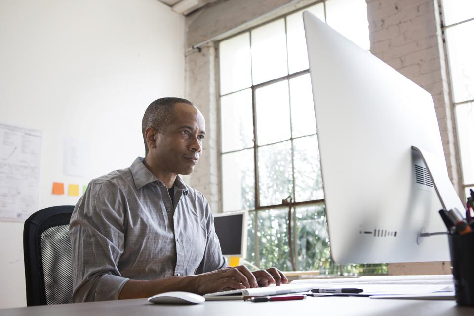 African American architect working in office