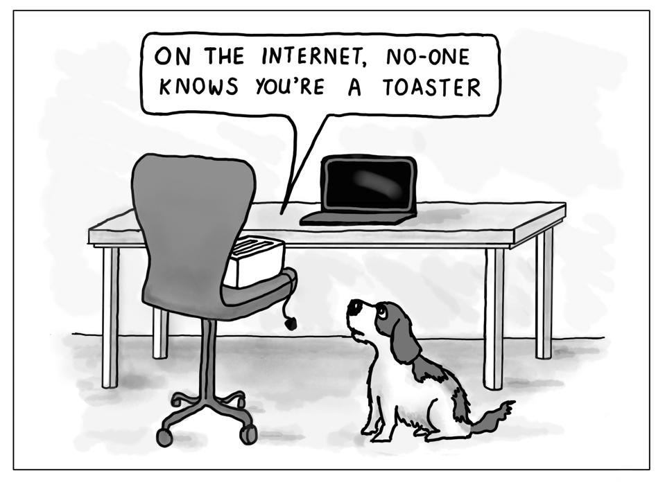 A toaster looking at a laptop is talking to a dog.