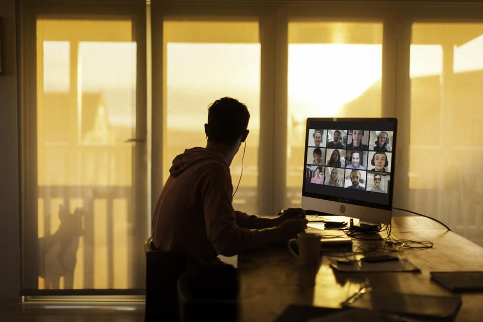 Young man on remote working team video call from his home during lockdown