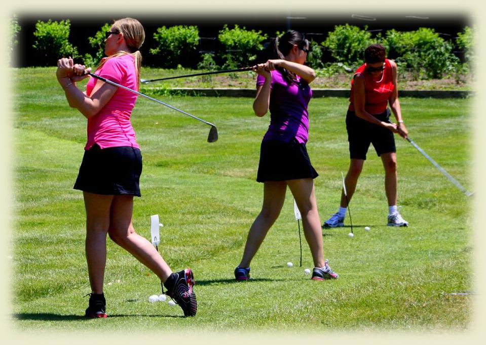Golfers taking practice swings at Winding Hills Golf Club.