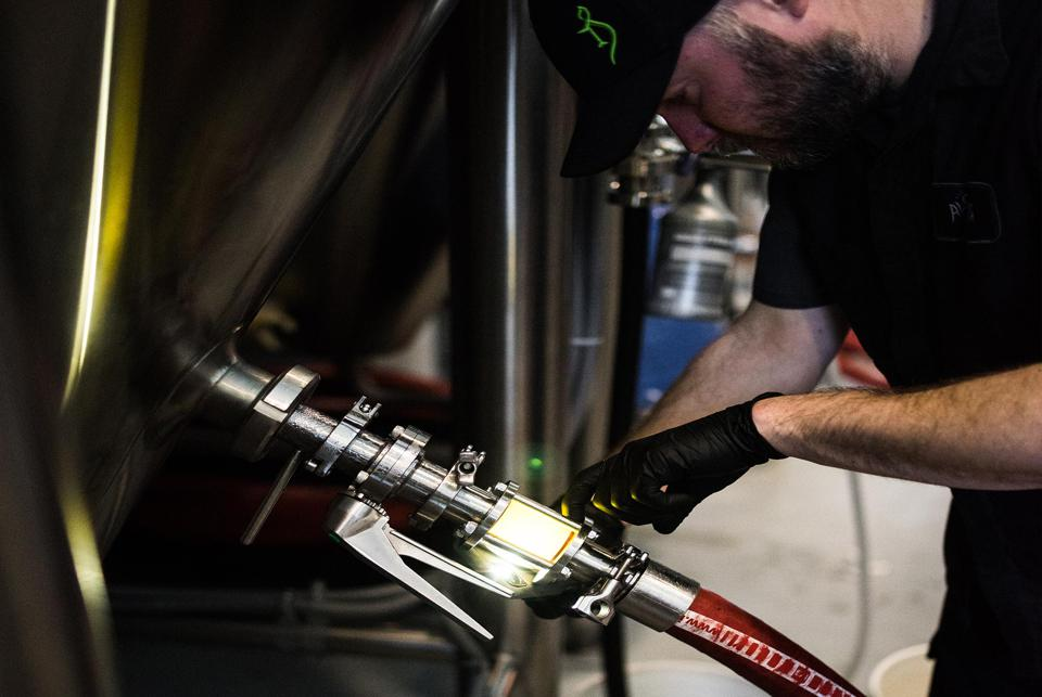 A brewer makes beer at The Alchemist Brewery in Stowe, Vermont