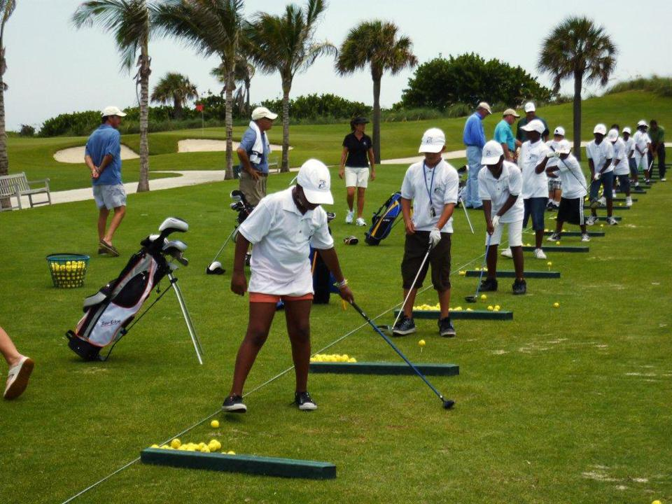 Golfers practicing at Palm Beach Golf Course.