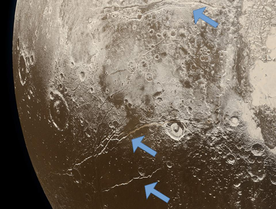 Extensional faults (arrows) on the surface of Pluto indicate expansion of the dwarf planet's icy crust, attributed to freezing of a subsurface ocean.