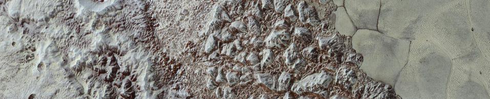 The images form a strip 50 miles (80 kilometers) wide, trending (top to bottom) from the edge of ″badlands″ northwest of the informally named Sputnik Planum, across the al-Idrisi mountains, onto the shoreline of Pluto's ″heart″ feature, and just into its icy plains.