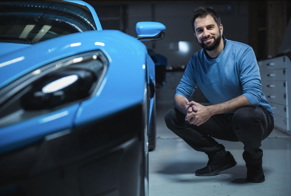 Rimac Automobili director of design, Adriano Mudri, next to the C_Two electric hypercar.
