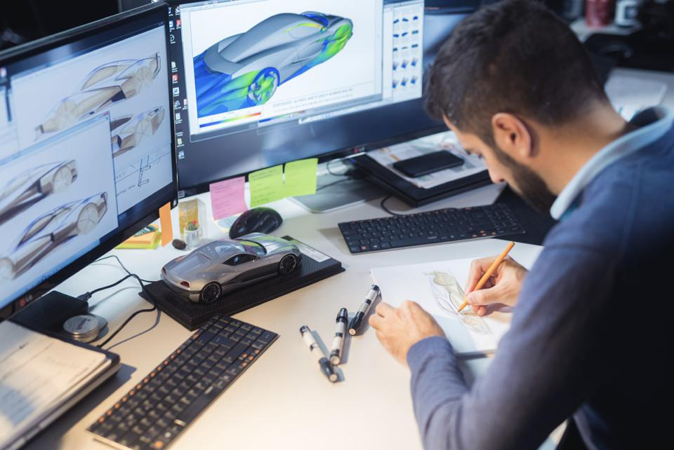 Rimac Automobili director of design Adriano Mudri sketching in the design studio.