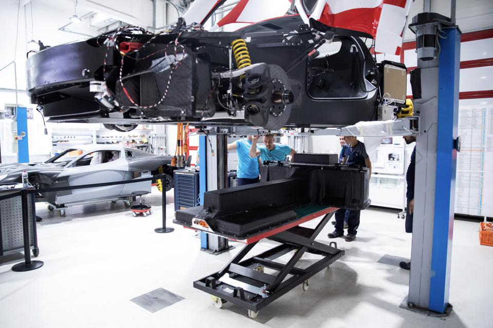 The battery pack of a Rimac C_Two electric car being inserted at the factory.