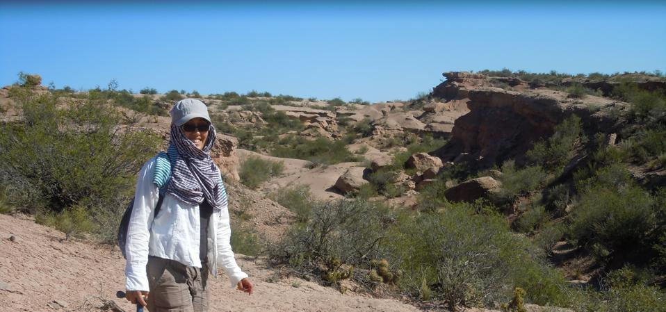 Catalina Suarez doing paleontological prospection in the Hayquerias Desert in Argentina