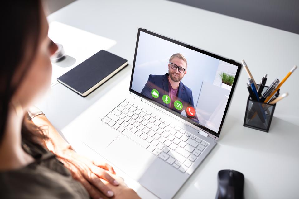 Businesswoman Video Conferencing With Coworker