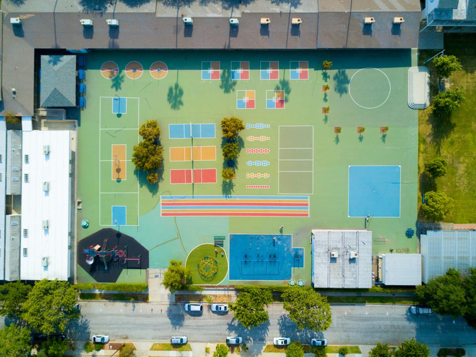 Arial view of colorful but empty playground. The post-apocalyptic vibe is palatable.