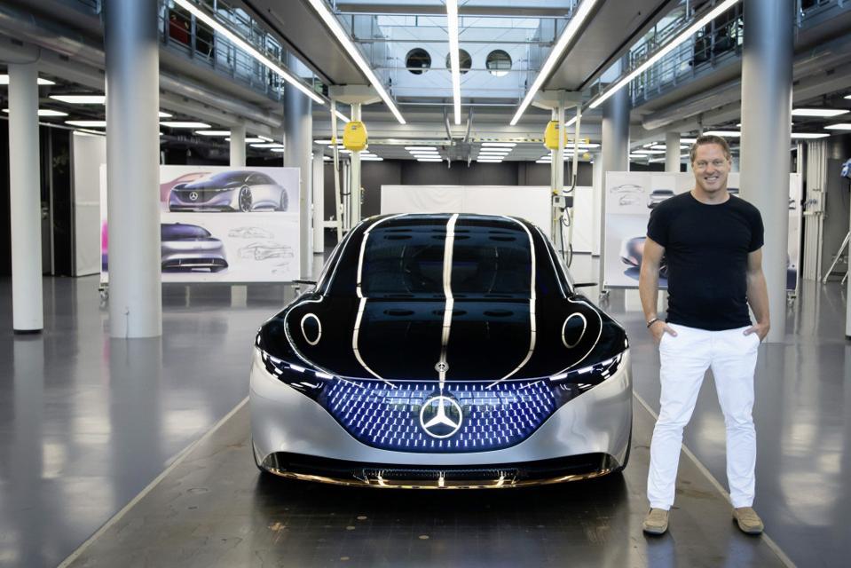 Gorden Wagener stands next to his 2019 Mercedes Vision EQS