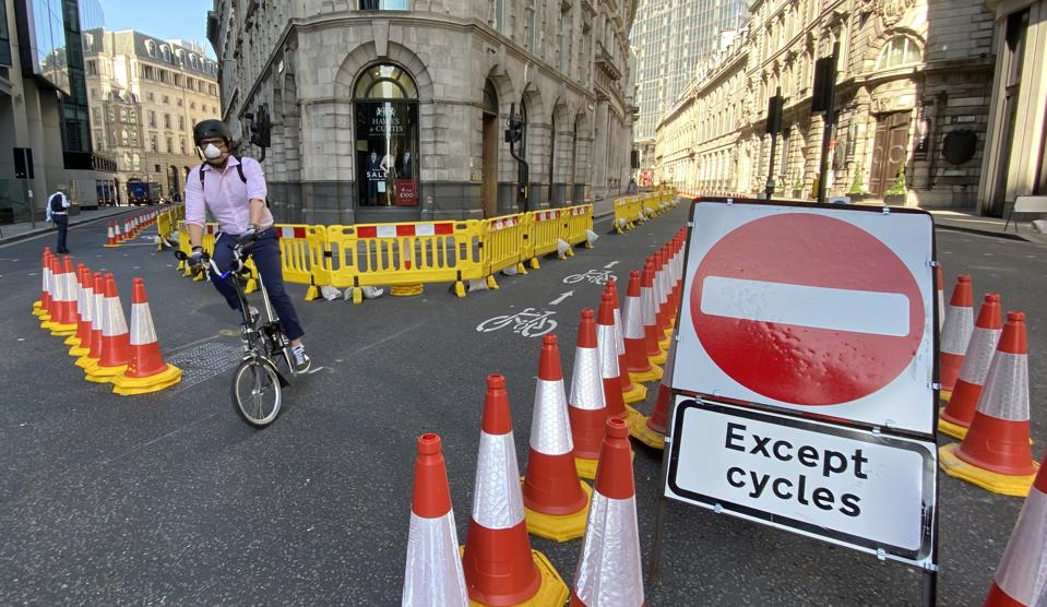 Cyclist Threadneedle Street, City of London.