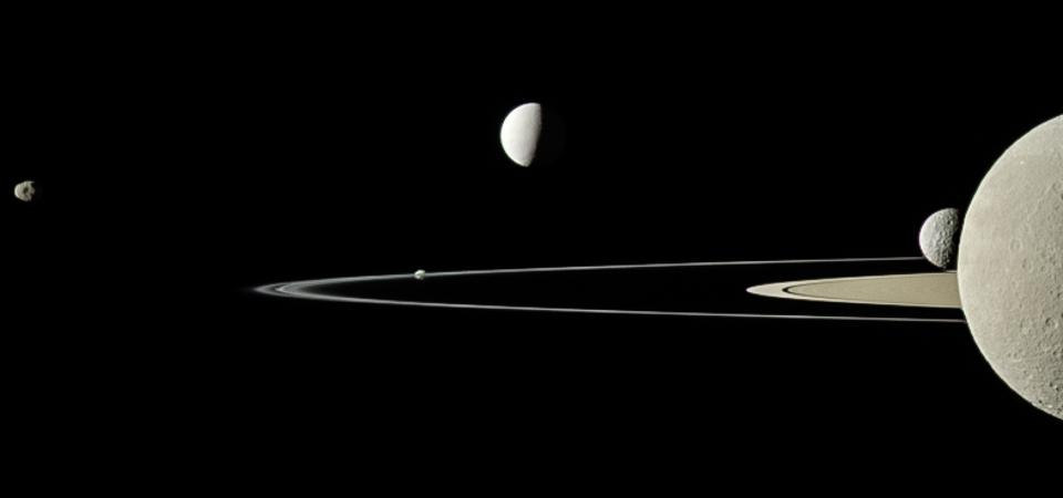 On July 29, 2011, Cassini captured five of Saturn's moons in a single frame with its narrow-angle camera.