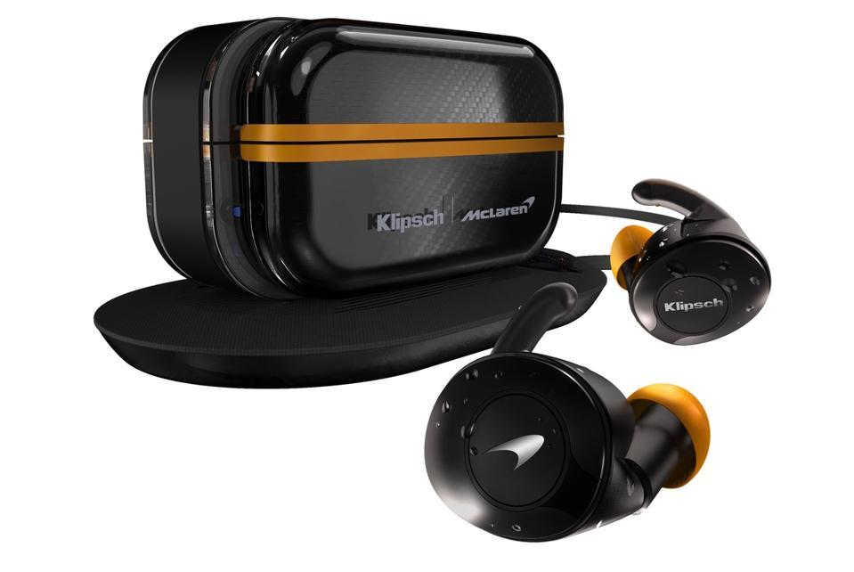 Klipsch T5 II True Wireless Sport McLaren edition earphones next to the charging case