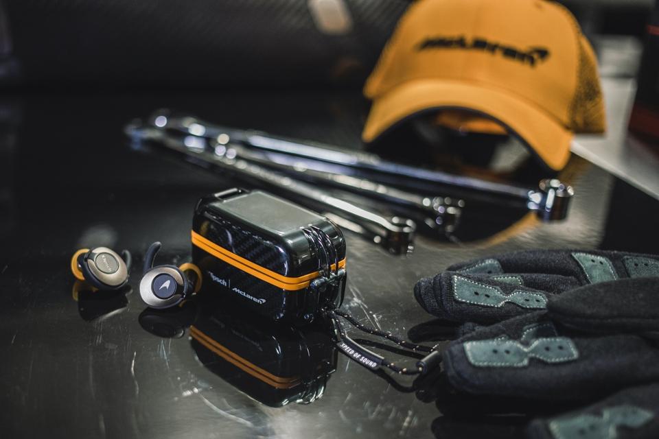 Klipsch T5 II True Wireless Sport McLaren edition next to some spanners and gloves