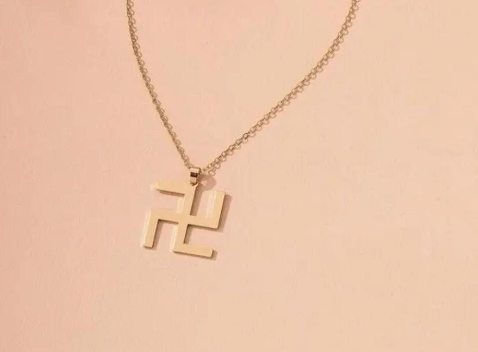 A screenshot of the ″Swastika Pendant Necklace″ that was sold on the Shein website.