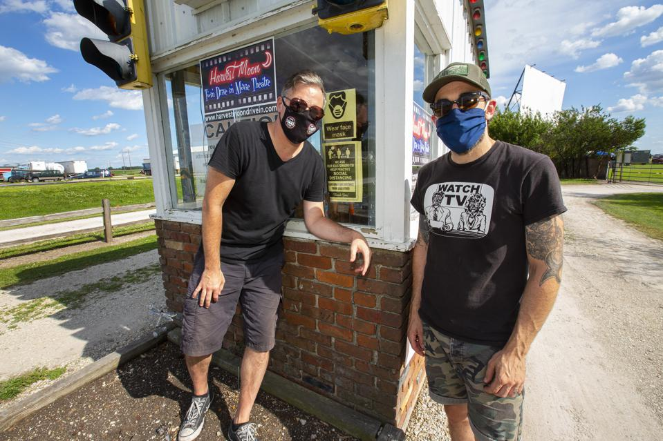 ″Wear face mask″ reads the sign as Scott Lucas (left) and Ryan Harding (right) of Local H gear up for a pair of socially distanced drive-in concerts. Thursday, June 25, 2020 at Harvest Moon Twin Drive-In Movie Theatre in Gibson City, IL (Photo by Barry Brecheisen)