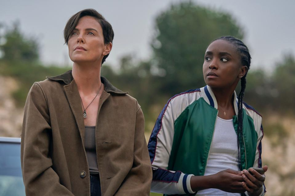 Charlize Theron as Andy and Kiki Layne as Nile in Netflix's 'THE OLD GUARD'