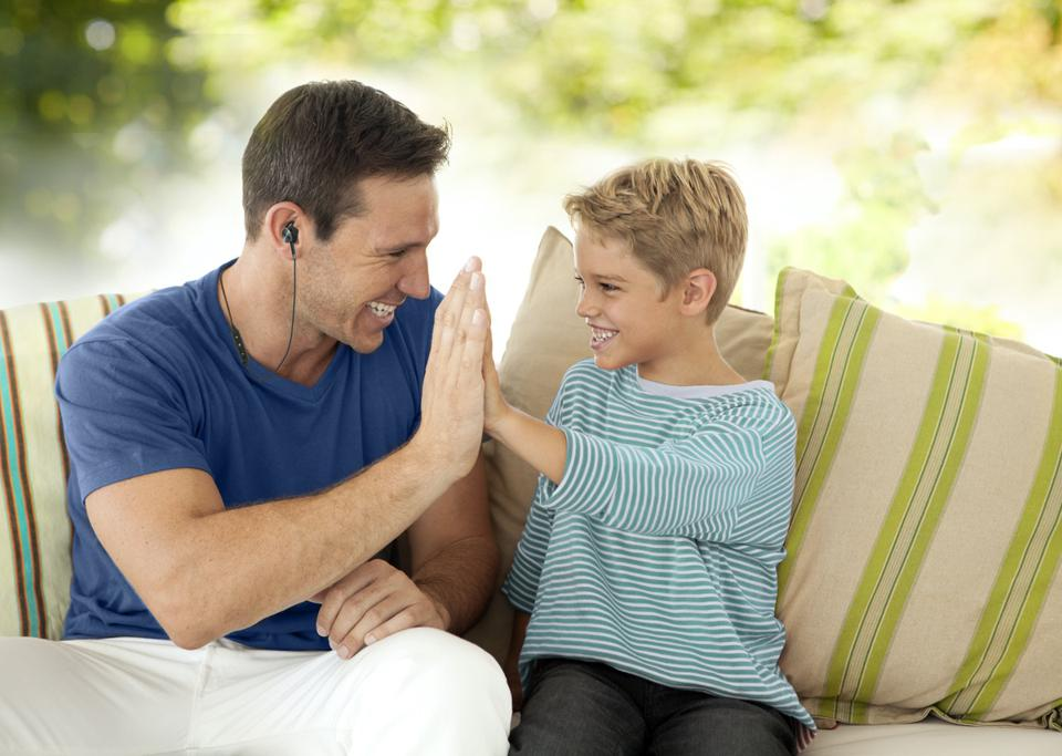 Man and child sitting on a sofa