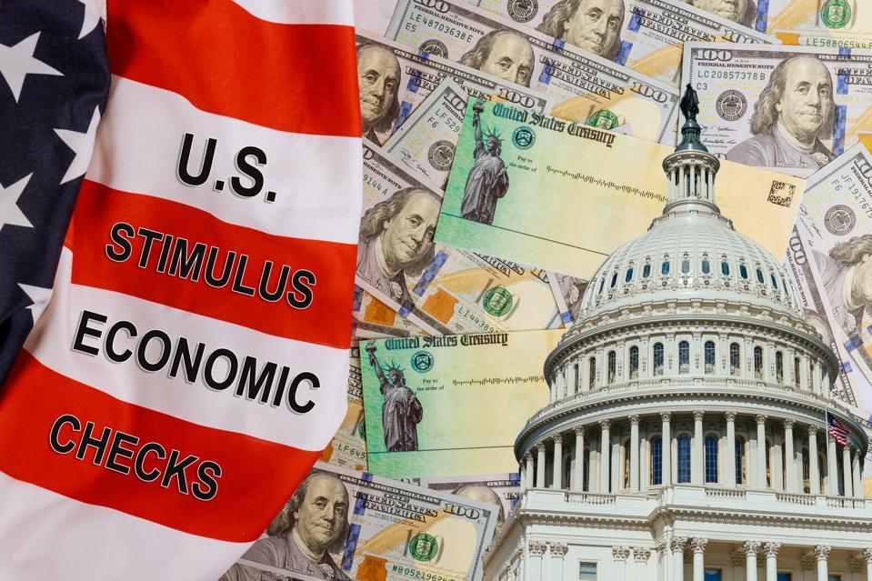 U.S. Economic STIMULUS CHECKS Bill Coronavirus financial relief checks from government USA dollar cash banknote on American flag Global pandemic Covid 19 lockdown