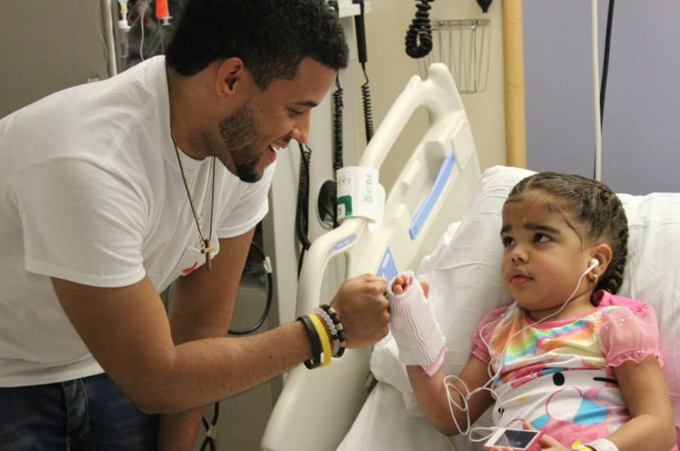 Music Beats Hearts volunteer with a young female patient