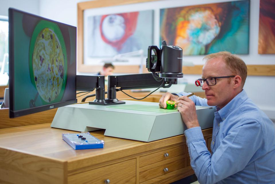 English watchmaker Roger W. Smith at the workbench